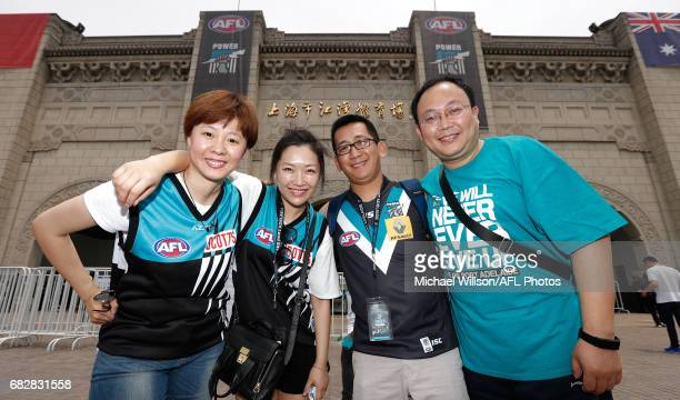 Power fans pose for a photograph during the 2017 AFL round 08 match between the Gold Coast Suns and Port Adelaide Power at Jiangwan Sports Stadium on...