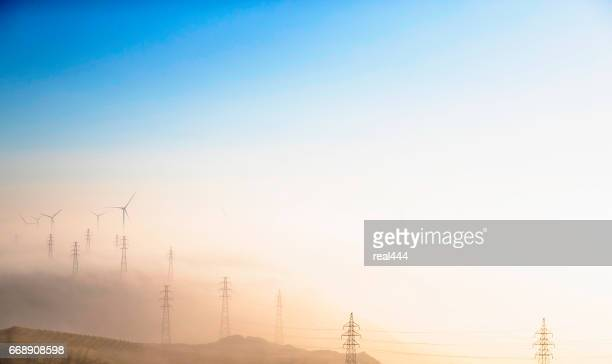 Power Generating Windmills and Electricity pylon