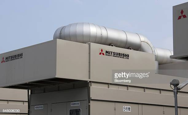 Power generators using gaspowered engines stand at the Mitsubishi Heavy Industries Engine Turbocharger Ltd plant in Sagamihara Kanagawa Prefecture...