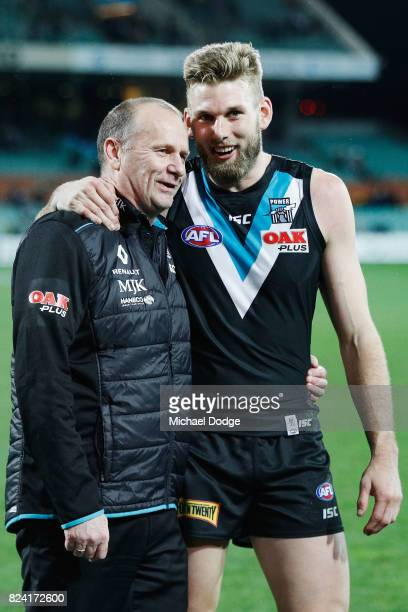 Power head coach Ken Hinkley and Jackson Trengove of the Power celebrate the win during the round 19 AFL match between the Port Adelaide Power and...