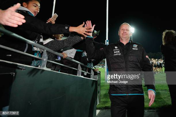 Power head coach Ken Hinkley celebrates the win during the round 19 AFL match between the Port Adelaide Power and the St Kilda Saints at Adelaide...