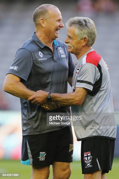 Power head coach Ken Hinkley hugs a former colleague during the JLT Community Series AFL match between the St Kilda Saints and the Port Adelaide...