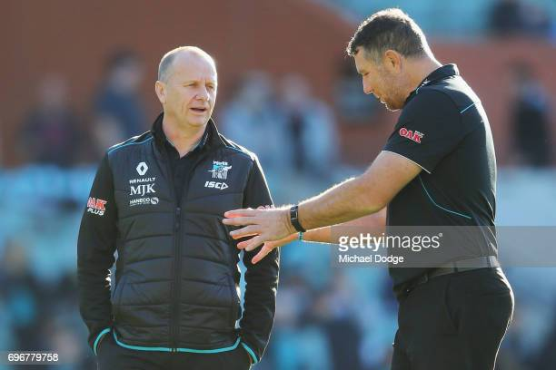 Power head coach Ken Hinkley listens to assistant Brendon Lade during the round 13 AFL match between the Port Adelaide Power and the Brisbane Lions...
