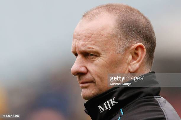 Power head coach Ken Hinkley looks upfield during the round 18 AFL match between the Melbourne Demons and the Port Adelaide Power at Melbourne...
