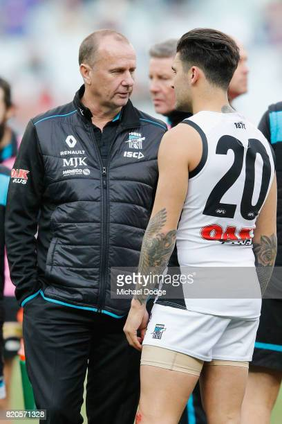 Power head coach Ken Hinkley speaks to Chad Wingard of the Power at at three quarter time during the round 18 AFL match between the Melbourne Demons...
