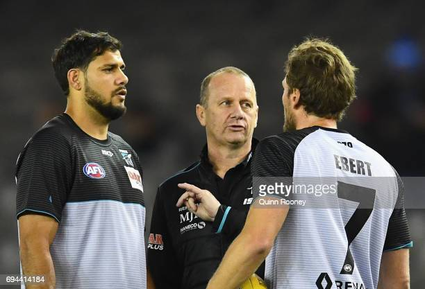 Power head coach Ken Hinkley speaks to Patrick Ryder and Brad Ebert of the Power during the round 12 AFL match between the Essendon Bombers and the...