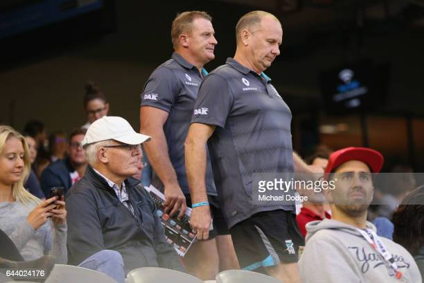 Power head coach Ken Hinkley walks to the quarter time huddle with assistant Michael Voss during the JLT Community Series AFL match between the St...