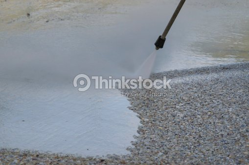 power jet wash of exposed aggregate concrete 3 stock photo. Black Bedroom Furniture Sets. Home Design Ideas