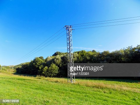 Power line column on meadow : Stock Photo