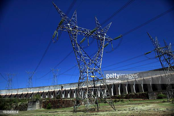 Power lines carry electricity generated by the Itaipu dam near Foz do Iguacu Brazil on Thursday Oct 18 2012 The hydroelectric dam located on the...