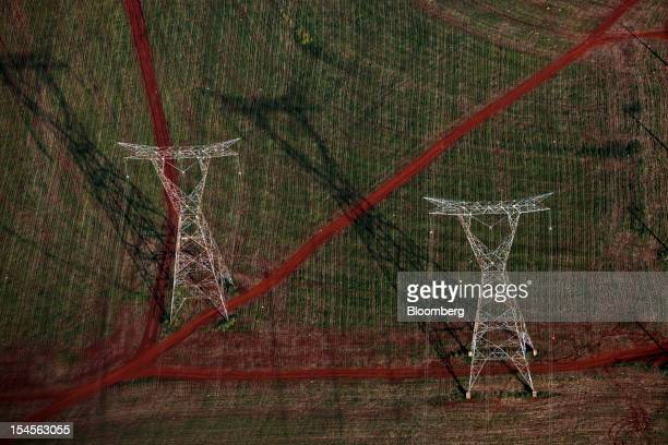 Power lines carry electricity generated by the Itaipu dam stand in this aerial photo taken near Foz do Iguacu Brazil on Thursday Oct 18 2012 The...