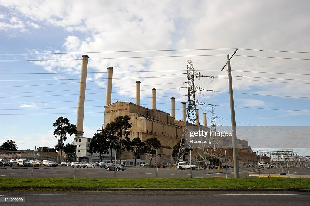 Power lines cross in front of International Power Plc's Hazelwood coal-fired power station in the Latrobe Valley, Australia, on Wednesday, Sept. 7, 2011. Australian prime minister Julia Gillard's plan to make factories and utilities either cut the nation's greenhouse gases or pay for pollution-curbing programs abroad may force companies to buy an average 66 million metric tons of credits a year starting in 2015, sending prices up 28 percent. Photographer: Carla Gottgens/Bloomberg via Getty Images