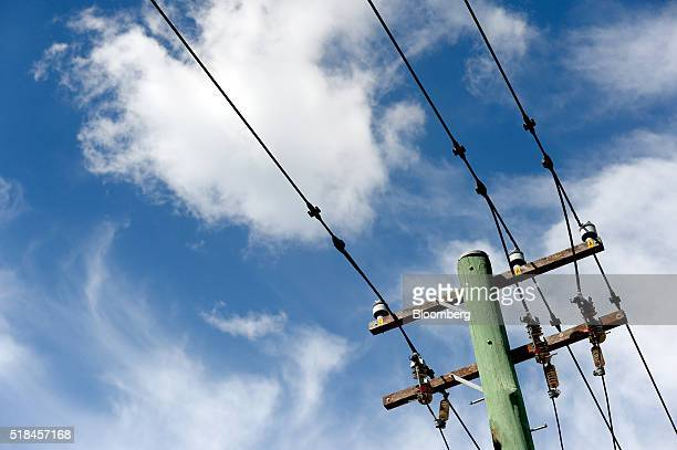 Power lines hang from an Ausgrid transmission pole in Sydney Australia on Wednesday March 23 2016 While State Grid Corp of China is hardly a...