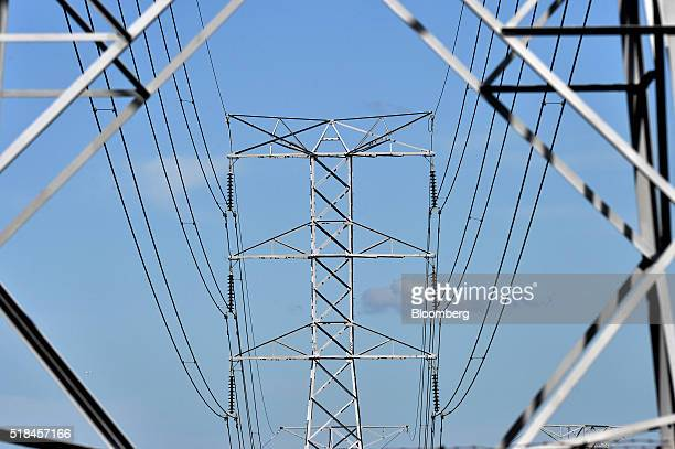 Power lines hang from an Ausgrid transmission tower in Sydney Australia on Wednesday March 23 2016 While State Grid Corp of China is hardly a...