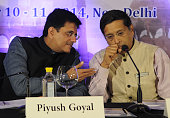 Power Minister Piyush Goyal talking with Chief Economic Advisor Arvind Subramanian at Delhi Economics Conclave 2014 on December 10 2014 in New Delhi...