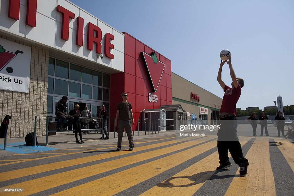 TORONTO, ON -AUGUST 26 - A power outage affected a stretch of the Danforth between about Guest Street to before Victoria Park Avenue in Toronto, August 26, 2014. Here, Canadian Tire employees play a game of volleyball as they wait for the power to go back on.