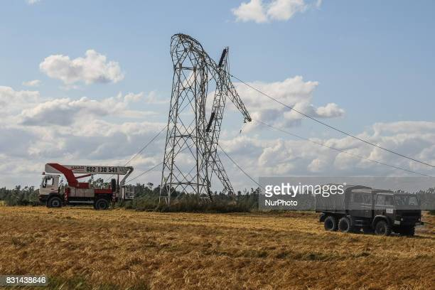 Power plant repair team repairing high voltage energy pole twisted by the wind is seen in the Nakla village northern Poland on 14 August 2017 Storms...