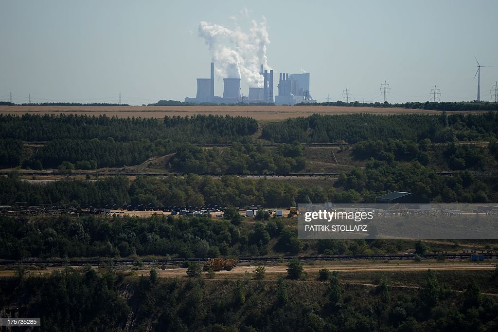 A power plant run by coal from the brown coal open cast mine Garzweiler is pictured on August 5, 2013 in Immigrath, western Germany. The small town Immerath and surrounding towns will be wiped off the map to allow energy giant RWE enlarge the huge open pit mine Garzweiler. AFP PHOTO / PATRIK STOLLARZ