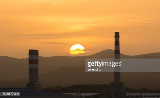 Power plant with setting sun : Stock Photo
