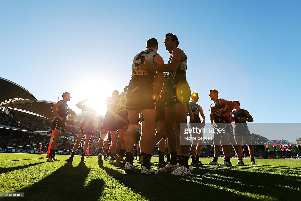 Power players celebrate after the round 4 AFL game between Port Adelaide and the Brisbane Lions at Adelaide Oval on April 12, 2014 in Adelaide, Australia.