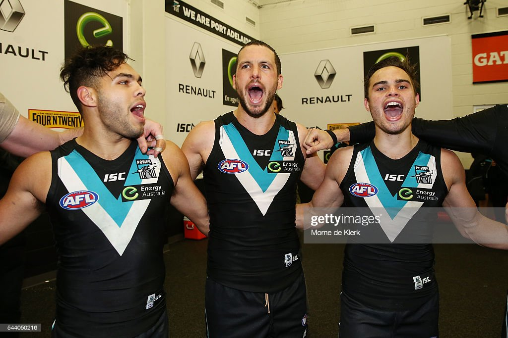 Power players celebrate after winning during the round 15 AFL match between the Port Adelaide Power and the Richmond Tigers at Adelaide Oval on July 1, 2016 in Adelaide, Australia.