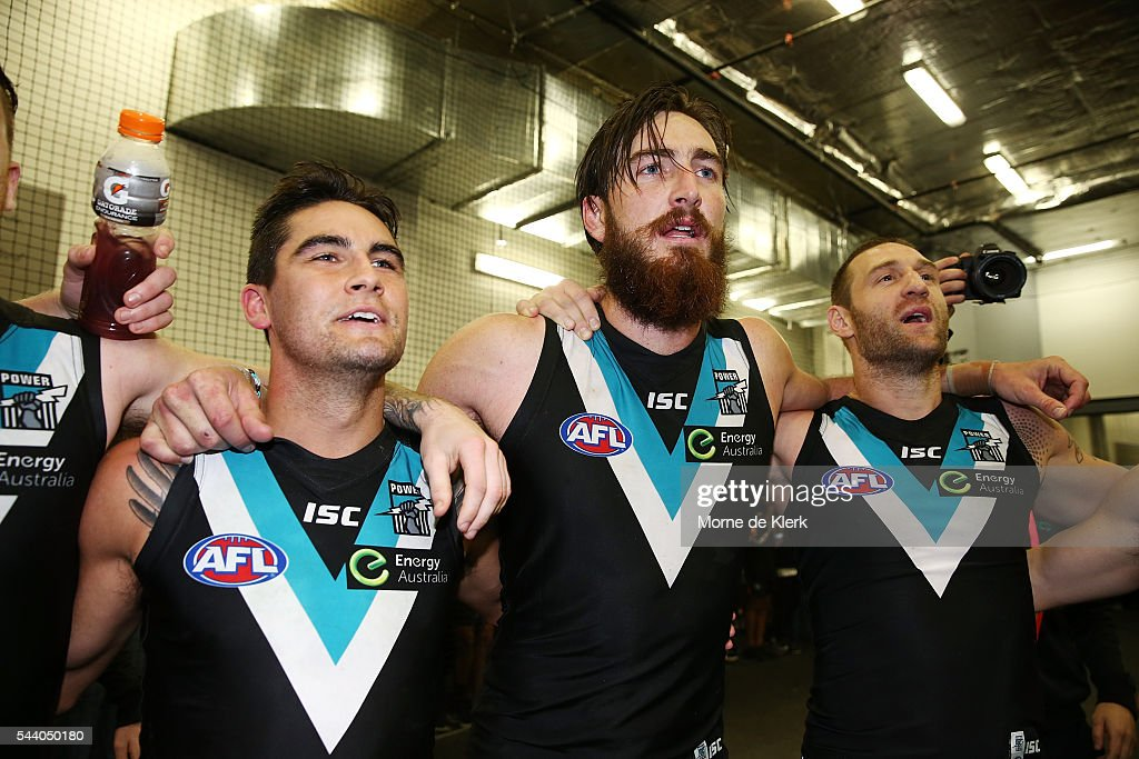 Power players celebrate after winning the round 15 AFL match between the Port Adelaide Power and the Richmond Tigers at Adelaide Oval on July 1, 2016 in Adelaide, Australia.