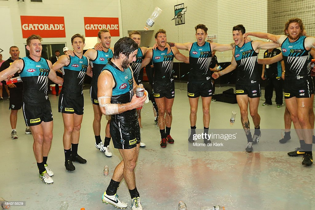 Power players celebrate in the changerooms with first time player Sam Gray after the round 4 AFL game between Port Adelaide and the Brisbane Lions at Adelaide Oval on April 12, 2014 in Adelaide, Australia.
