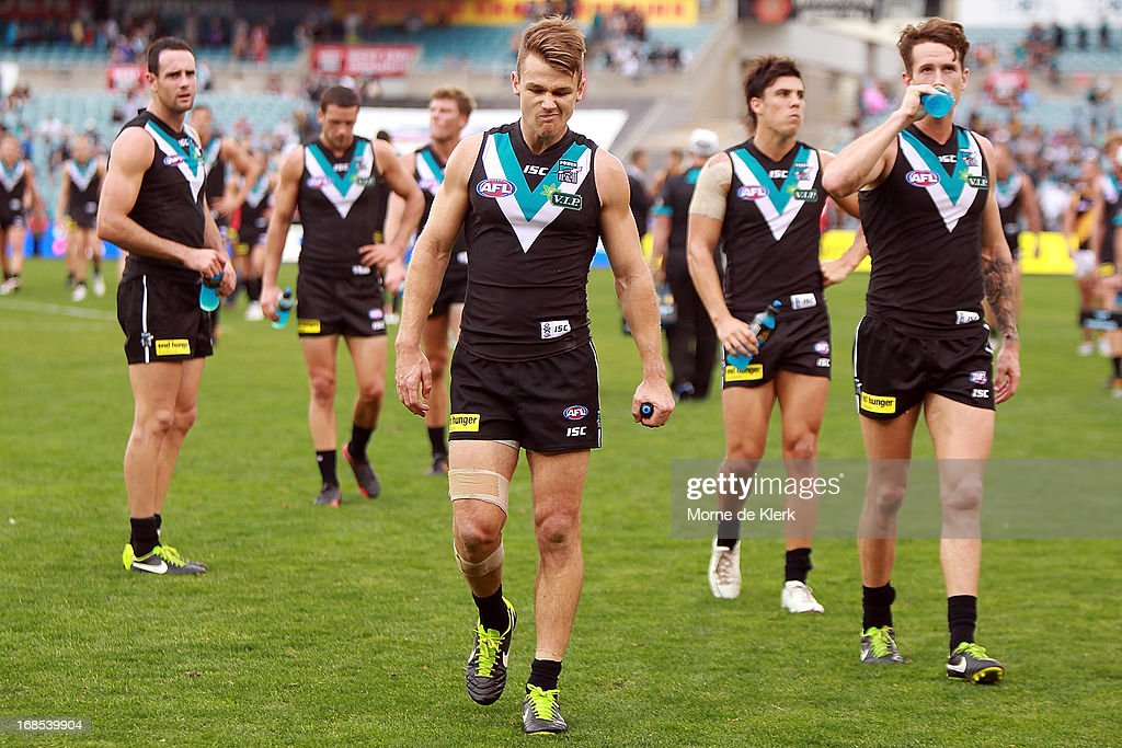 Power players leave the field after the round seven AFL match between Port Adelaide Power and the Richmond Tigers at AAMI Stadium on May 11, 2013 in Adelaide, Australia.