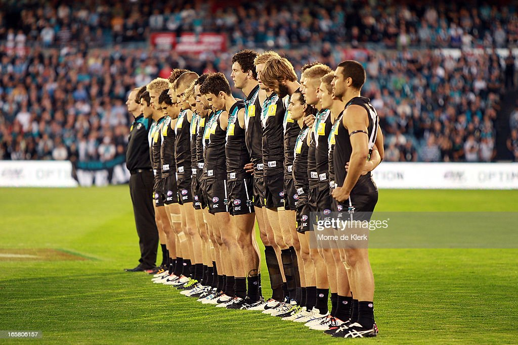 Power players line up before the round two AFL match between Port Adelaide Power and the Greater Western Sydney Giants at AAMI Stadium on April 6, 2013 in Adelaide, Australia.
