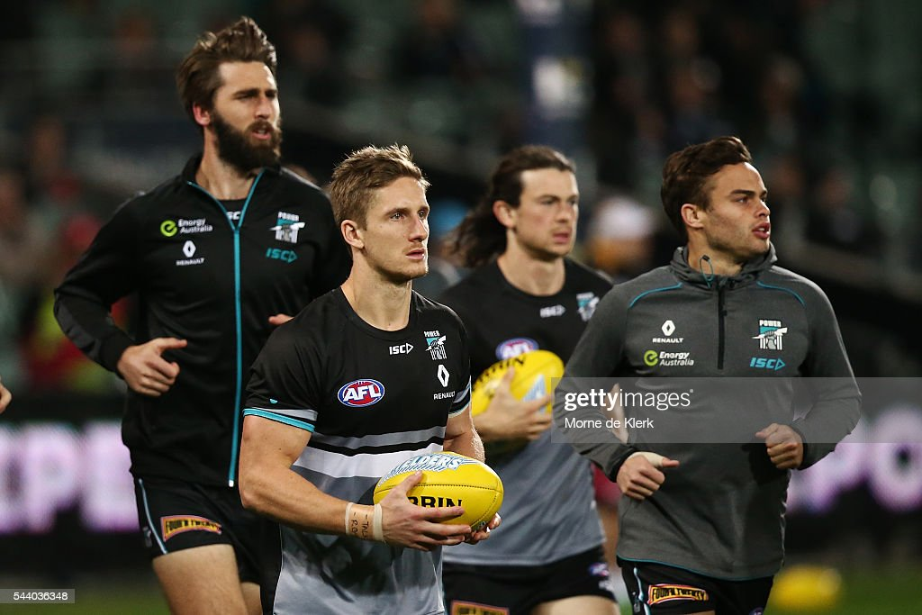 Power players warm up before the round 15 AFL match between the Port Adelaide Power and the Richmond Tigers at Adelaide Oval on July 1, 2016 in Adelaide, Australia.