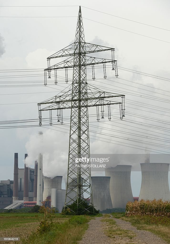 A power pole is pictured in front the new Neurath lignit coal-fired RWE power station on September 11, 2012 at Grevenbroich near Aachen, western Germany. RWE, one of Germany's major energy provider, invested in new coal conducted power plants.
