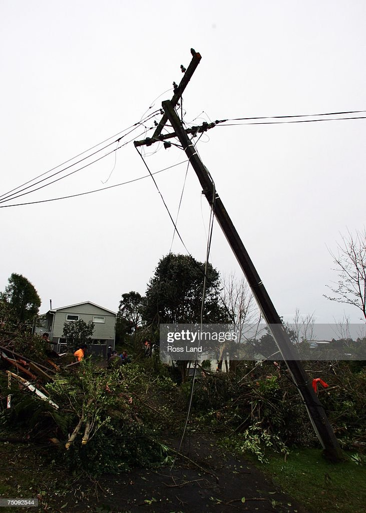 A power pole stands at an angle at the front of a property on July 6 2007 in the seaside towm of Oakura south west of New Plymouth New Zealand A...