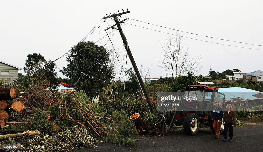 A power pole stands at an angle at the front of a property on July 6 2007 in the seaside town of Oakura south west of New Plymouth New Zealand A...
