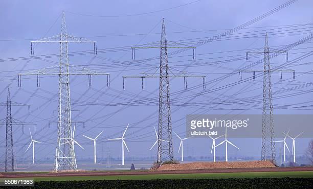 NIEDERAUSSEM power poles of RWE AG Windmills in the background
