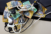 Australian dollars and power or electrical plugs.