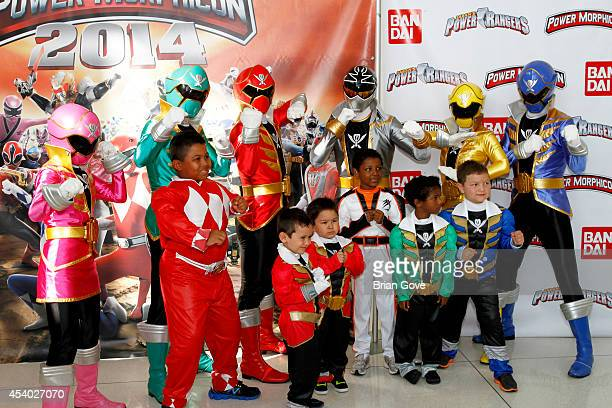 Power Rangers pose with their fans from Make A Wish Foundation at Pasadena Convention Center on August 23 2014 in Pasadena California