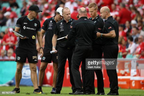 Power senior coach Ken Hinkley and his coaching staff prepare to speak to the team at halftime during the round one AFL match between the Sydney...