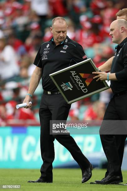 Power senior coach Ken Hinkley gives prepares to speak to his team at halftime during the round one AFL match between the Sydney Swans and the Port...