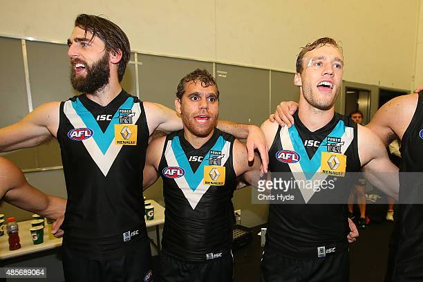 Power sing the team song after winning during the round 22 AFL match between the Gold Coast Suns and the Port Adelaide Power at Metricon Stadium on...