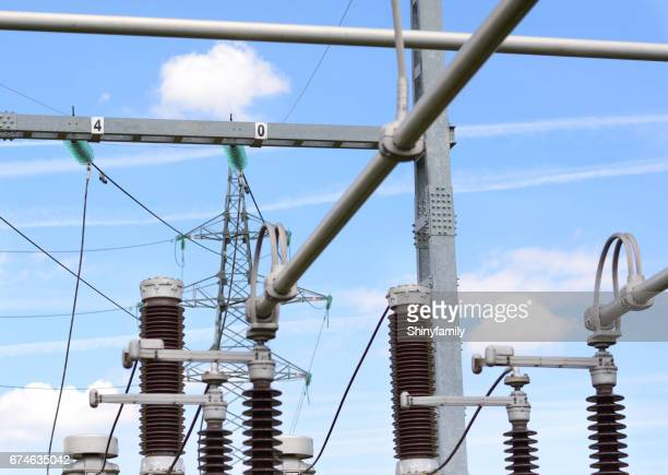 Power substation with insulators, power lines and blue sky