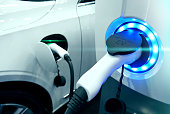 Power supply connect to electric vehicle for charge to the battery. Charging technology industry transport which are the futuristic of the Automobile. EV fuel Plug in hybrid car.