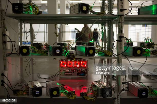Power supply units and cooling fans sit on shelves linked to cryptocurrency mining machines at the SberBit mining 'hotel' in Moscow Russia on...