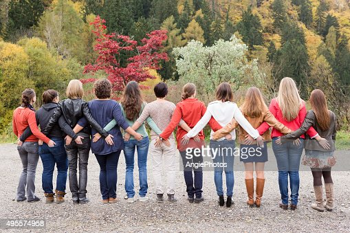 Power team of women from behind