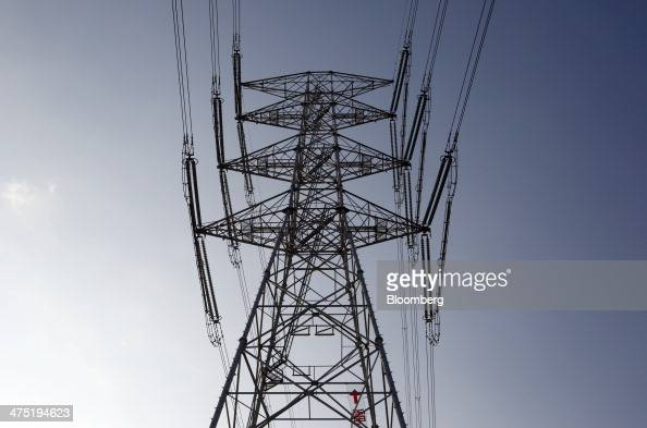 Power transmission lines are suspended from an electricity pylon near Chubu Electric Power Co's Hamaoka nuclear power station unseen in Omaezaki...