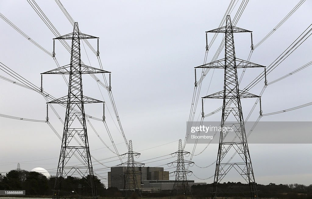 Power transmission lines run from Sizewell A, right, and B, left, nuclear power stations, operated by Electricite de France SA (EDF), in Sizewell, U.K., on Wednesday, Jan. 2, 2013. EDF operates eight U.K. atomic power stations and has proposed to add Areva reactors at its Hinkley Point and Sizewell sites. Photographer: Chris Ratcliffe/Bloomberg via Getty Images