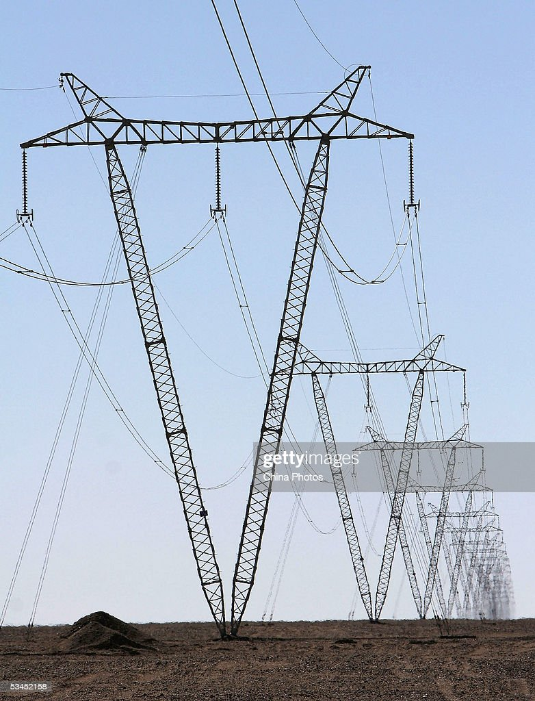 Power transmission towers are seen at the No 109 State Highway on August 22 2005 in Golmud of Qinghai Province northwest China According to state...