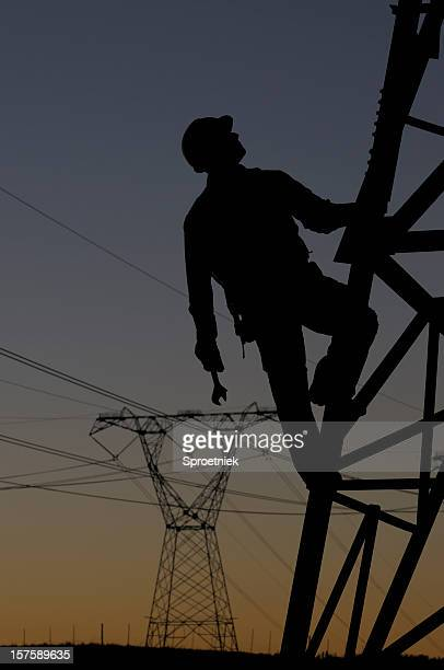 Power utility worker silhouetted