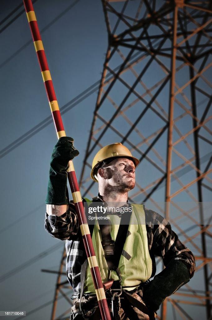 Power utility worker taking a break at dusk : Stock Photo