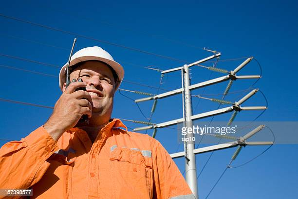 Power worker relaying info over walkie talkie
