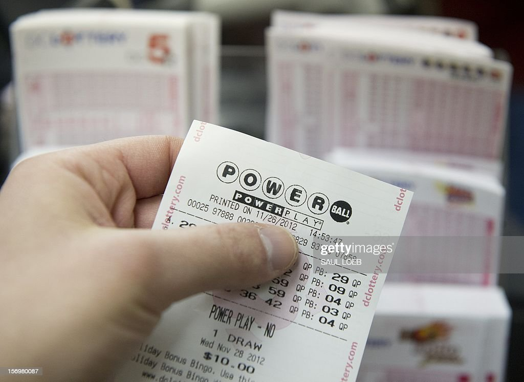 A Powerball lottery ticket for the estimated record 425 million USD jackpot prize, Powerball's biggest winnings ever, is seen in a convenience store in Washington on November 26, 2012. The previous drawing resulted in no winner, setting up for the record setting prize when numbers will be drawn on Wednesday. Tickets are sold in 42 US states, Washington, DC, and the US Virgin Islands. AFP PHOTO / Saul LOEB